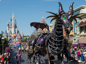 Disney parade down Mainstreet USA, with purple mechanical dragon