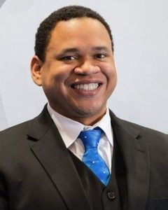 Benjamin Bryant in suit with blue tie