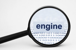 Magnifying glass showing the word engine among a background of zeros and ones